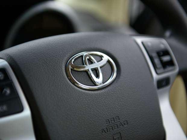 A steering wheel is seen on a Toyota Land Cruiser Prado SUV displayed at the company's head office in Tokyo, Japan.