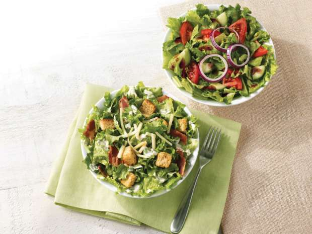 "Canada's largest quick serve restaurant chain debuted the new ""made to order"" salads this month at its Canadian restaurants: a garden salad topped by tomato, cucumber and red onion and served with balsamic vinaigrette, and a Caesar salad, retailing for $3.79 and $4.26, respectively."