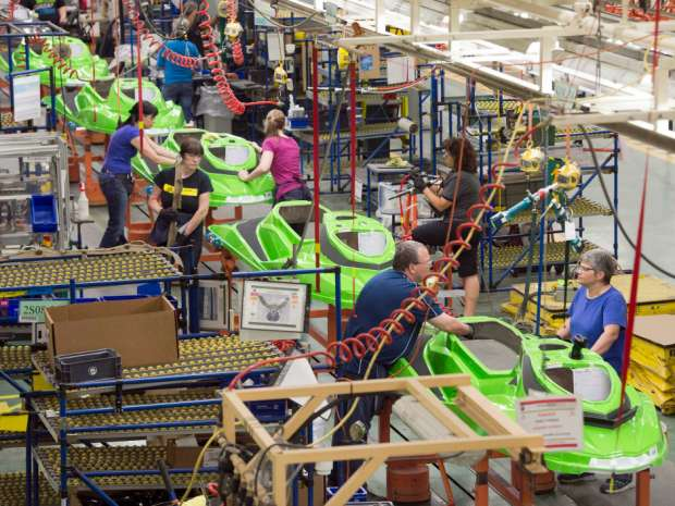 Employees work on the SeaDoo assembly line at the Bombardier Recreational Products plant in Valcourt, Que.