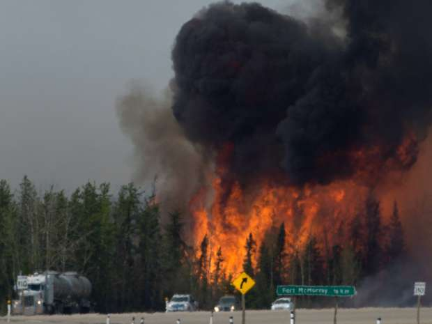 A wildfire sweeping through a heavily forested oilsands region near Fort McMurray could eventually cost $6 billion, according to one industry estimate.