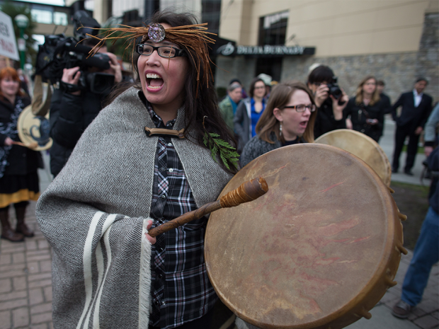 Audrey Siegl, of the Musqueam First Nation, chants and beats a drum during a protest outside National Energy Board hearings on the proposed Trans Mountain pipeline expansion in Burnaby, B.C., in January.