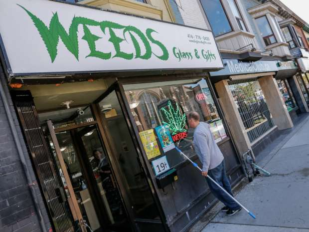 Spiros Custom Tailor sits sandwiched between three Medical marijuana Dispensaries on The Danforth in Toronto, Ont.
