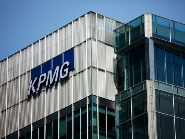 The KPMG logo sits on their offices in the Canary Wharf business and shopping district, in London.
