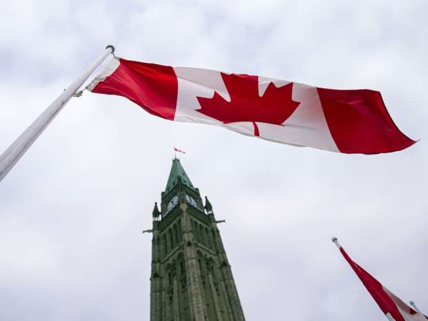 The Canadian flag above the Peace Tower on Parliament Hill in Ottawa.