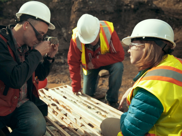 Kaminak Gold Corp.'s Coffee Gold Project south of Dawson City, Yukon. Kaminak president and CEO, Eira Thomas, right, with Kaminak executive chairman, John Robins, and Kaminak vice-president exploration Tim Smith looking at samples in a trench at Coffee.