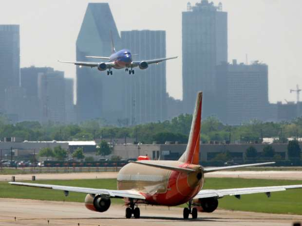 A Southwest Airlines flight prepares to depart as another Southwest jet arrives at Love Field in Dallas, Texas. The carrier's in the middle of acquiring 83 used Boeing 737-700s from around the world.