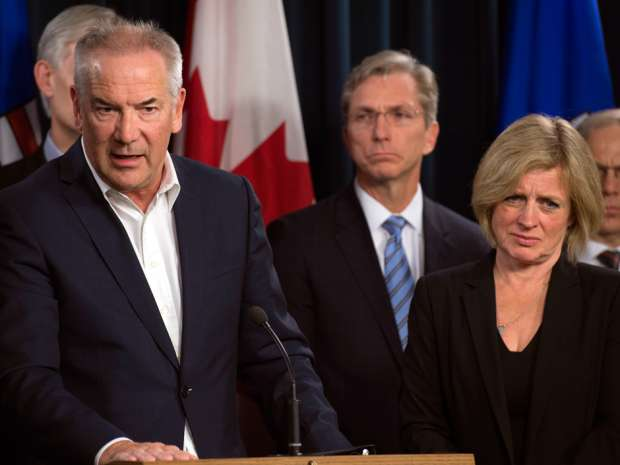 Steve Williams, President and CEO of Suncor speaks to the media along with Alberta Premier Rachel Notley on Tuesday.