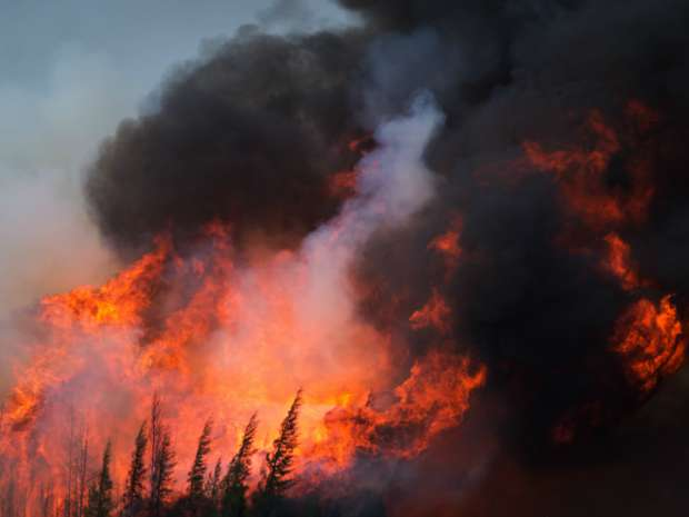 Industry analysts say projects could be re-started as soon as a week after the threat of the fire has passed, given potential complications with pipelines and power lines connected to the projects.