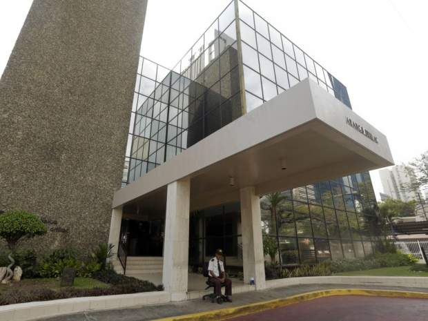 A police stand outside Mossack Fonseca law firm while Organized crime prosecutors raid the offices, in Panama City in April. Organized crime prosecutors raided the offices of the Mossack Fonseca law firm looking for evidence of money laundering and financing terrorism following a leak of documents about tax havens it set up for wealthy international clients.