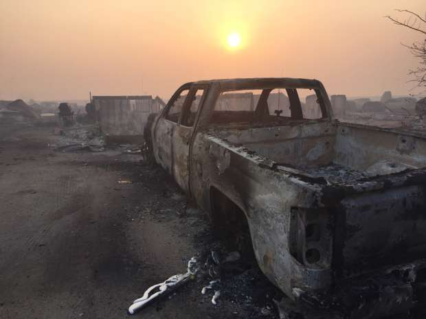 A burned-out truck in Fort McMurray, Alta. after wildfire swept the region. The fire in Canada's oilsands has stoked concern among investors over a supply shortage.