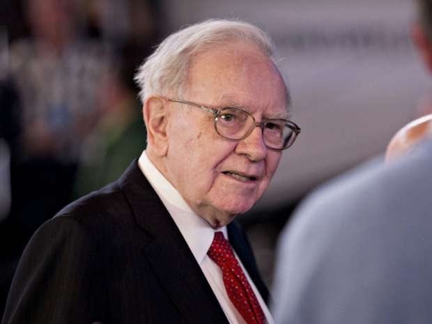 Warren Buffett, chairman and chief executive officer of Berkshire Hathaway Inc., greets attendees ahead of the Berkshire Hathaway Inc. annual shareholders meeting in Omaha, Nebraska, U.S., on Saturday, where among other things he discussed the presidential election.