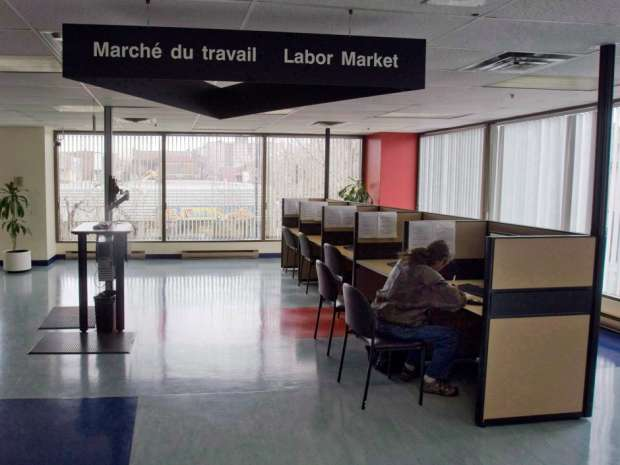 A man looks through jobs at a Resource Canada offices in Montreal.