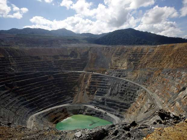 An aerial view of Newmont's copper and gold mining pit in Batu Hijau, eastern Indonesia